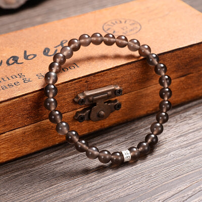Ice Obsidian Bracelet With The Six Syllable Mantra Sign Charm