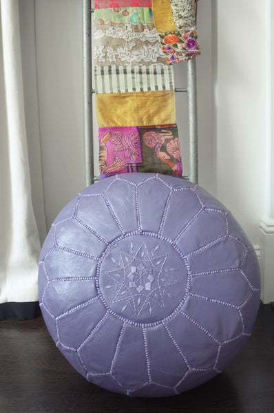 Purple leather pouf