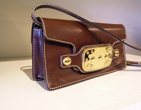 Chocolate brown leather pochette. celine