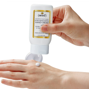 Seed Extra Moisturizing Hand Cream, in use, dispensing