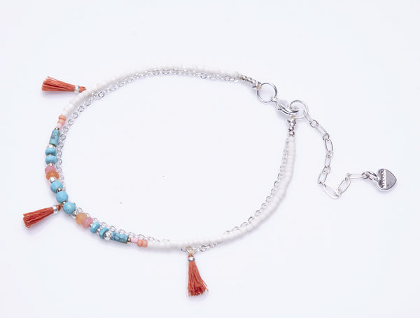 Layered Anklet with Tassels by Nakamol in white