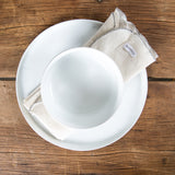 white napkin with grey serged edge