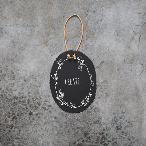small black hanging inspirational word wall sign