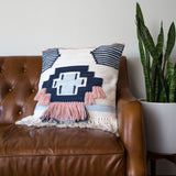 navy and pink southwestern patterned pillow