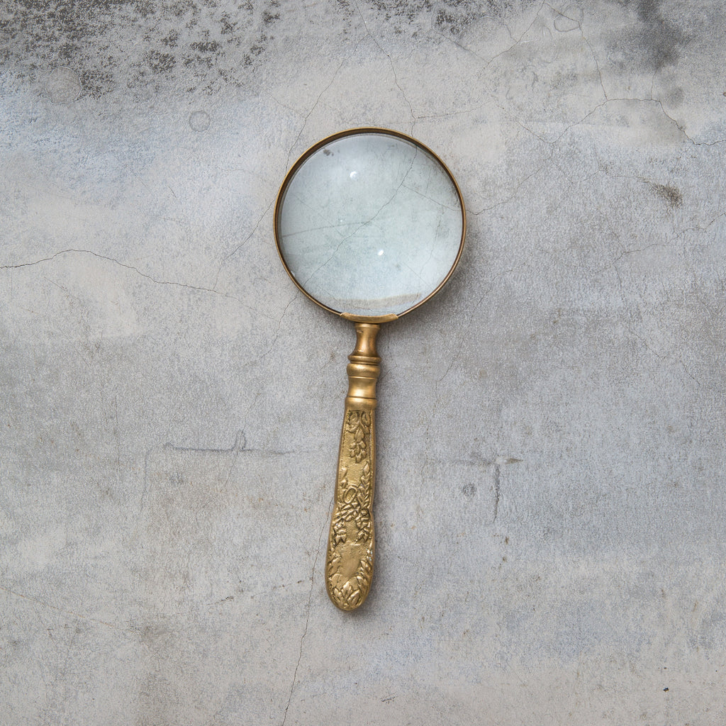large magnifying glass with decorative brass handle