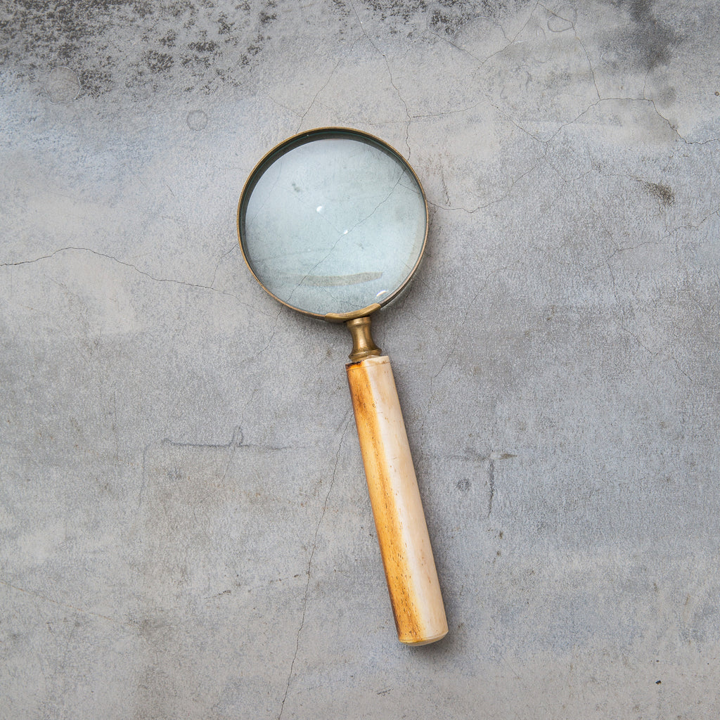 large magnifying glass with brown wooden handle
