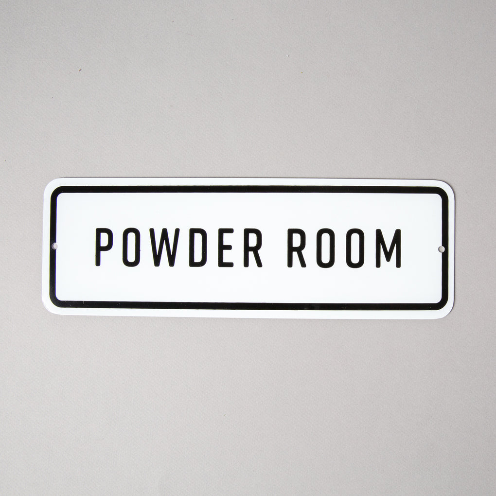 "enamel metal sign that reads ""powder room"""