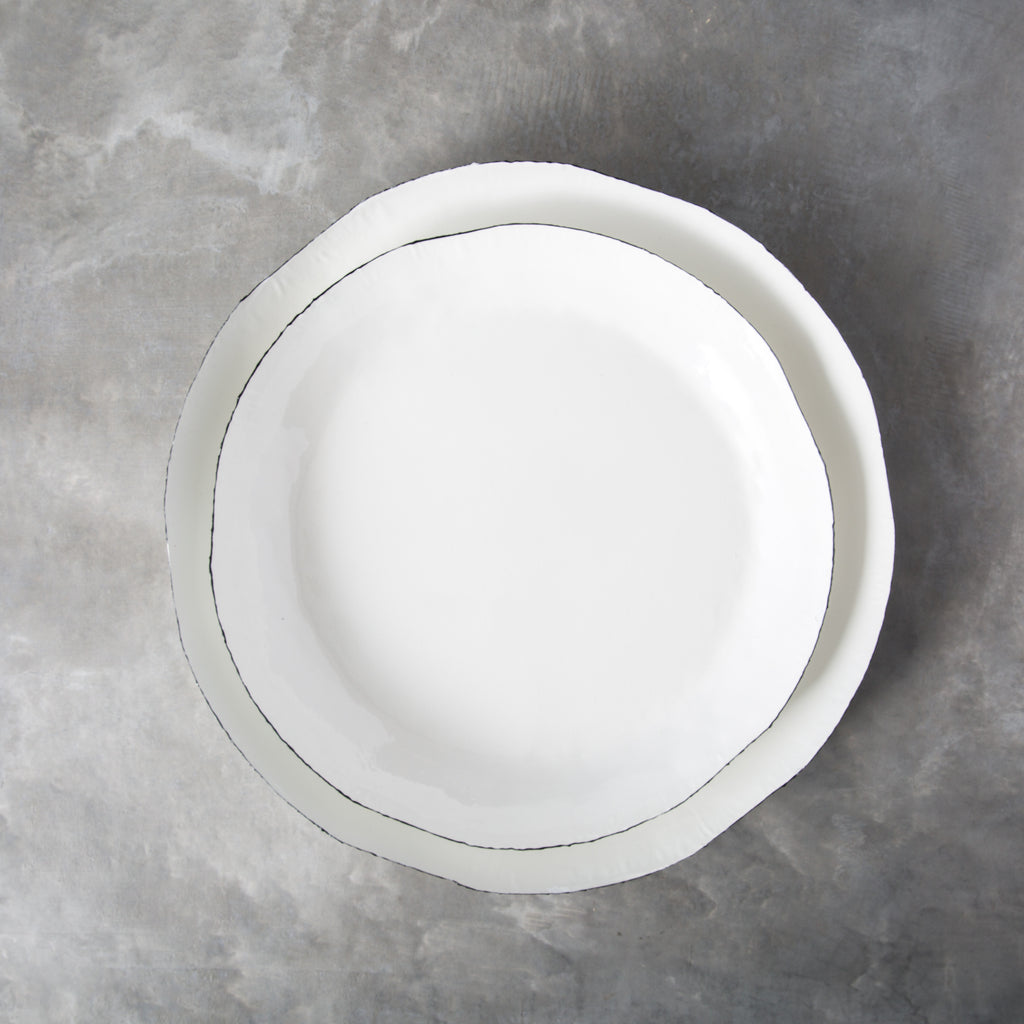 white enamel tray with black rim