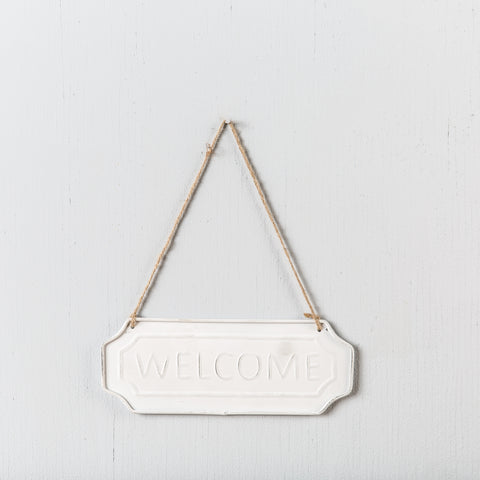 "hanging white ceramic ""welcome"" sign"