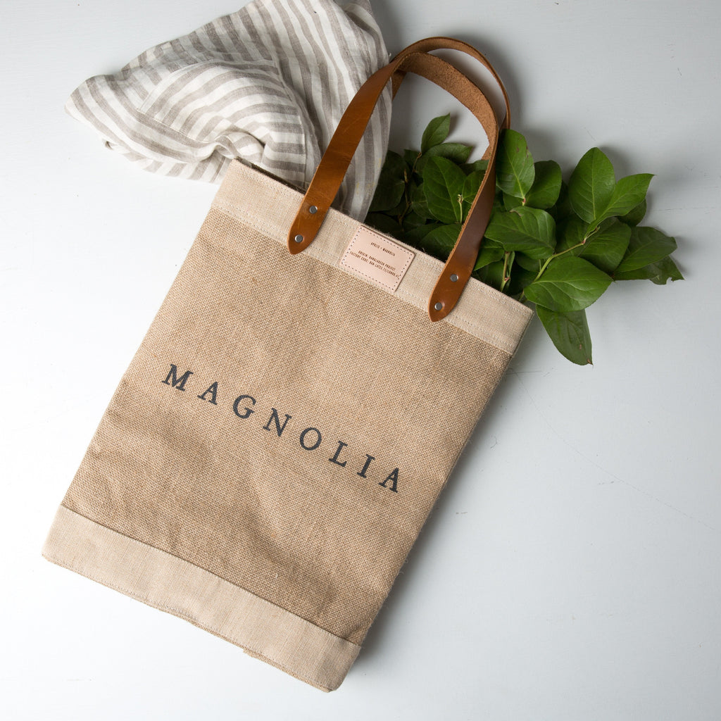 0d7cb00eb305 canvas tote with leather handles and magnolia logo