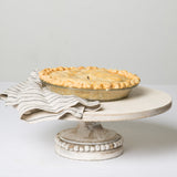 white wooden cake stand with beaded detail