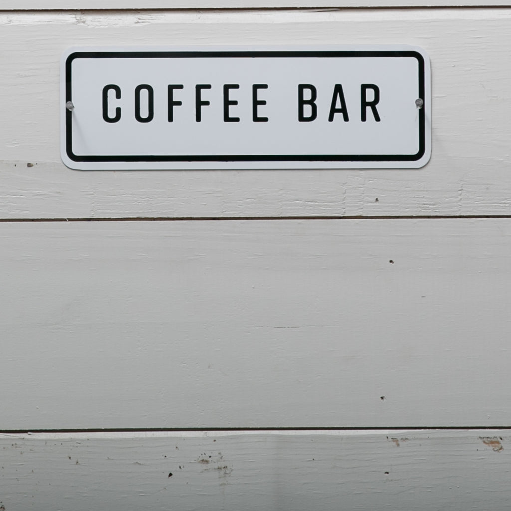 white enamel coffee bar sign with black outline