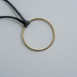 black leather necklace with brass hoop pendant