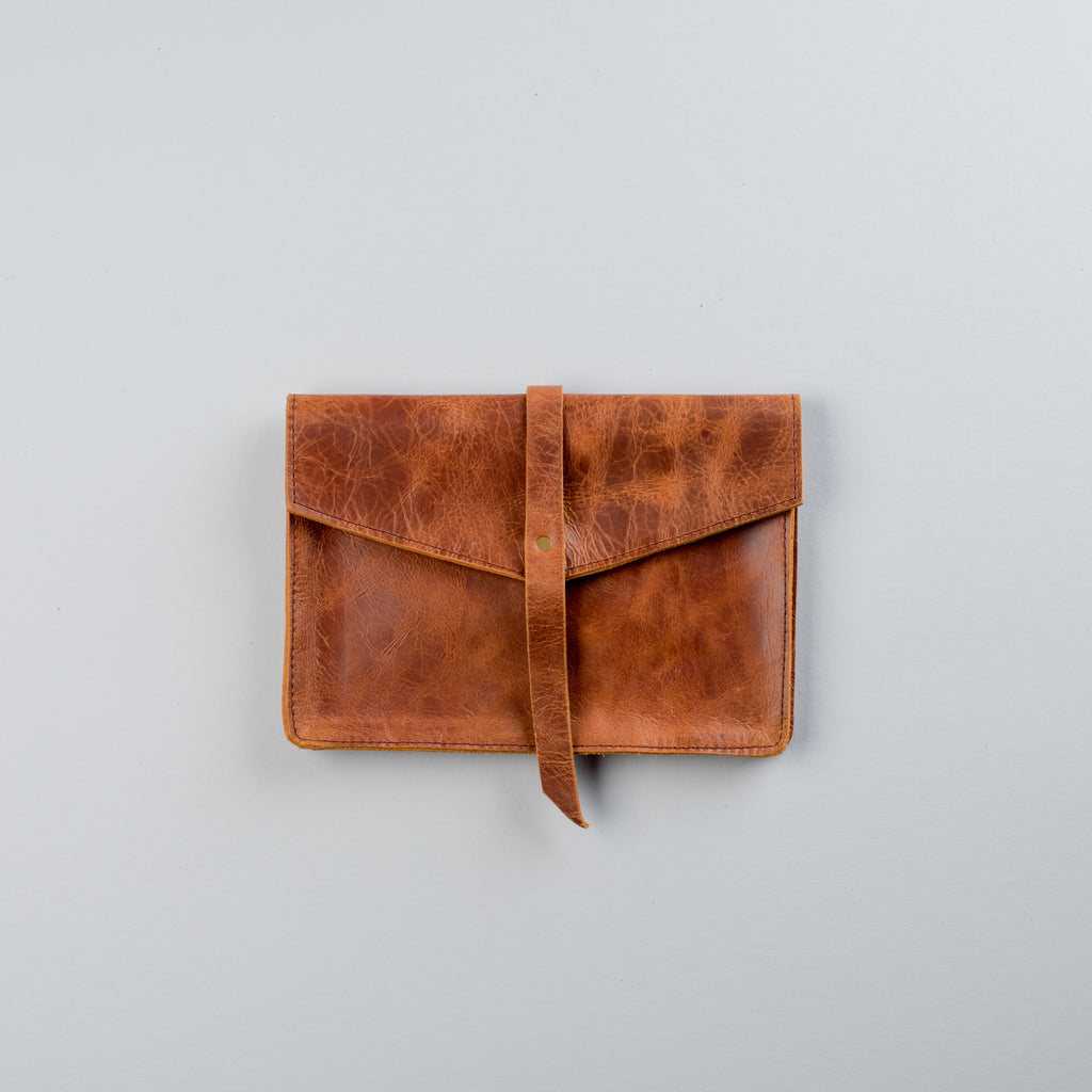 brown genuine leather clutch with magnetic clasp
