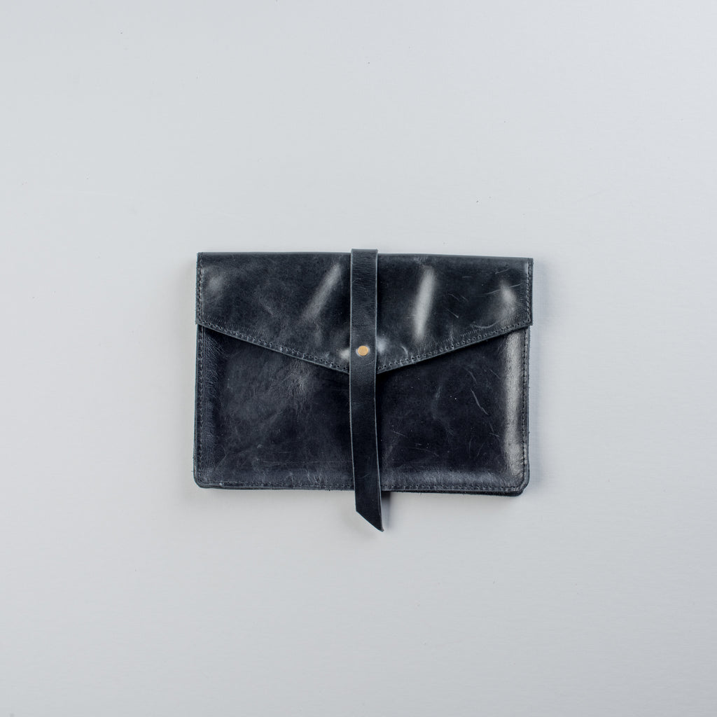 black genuine leather clutch with magnetic clasp