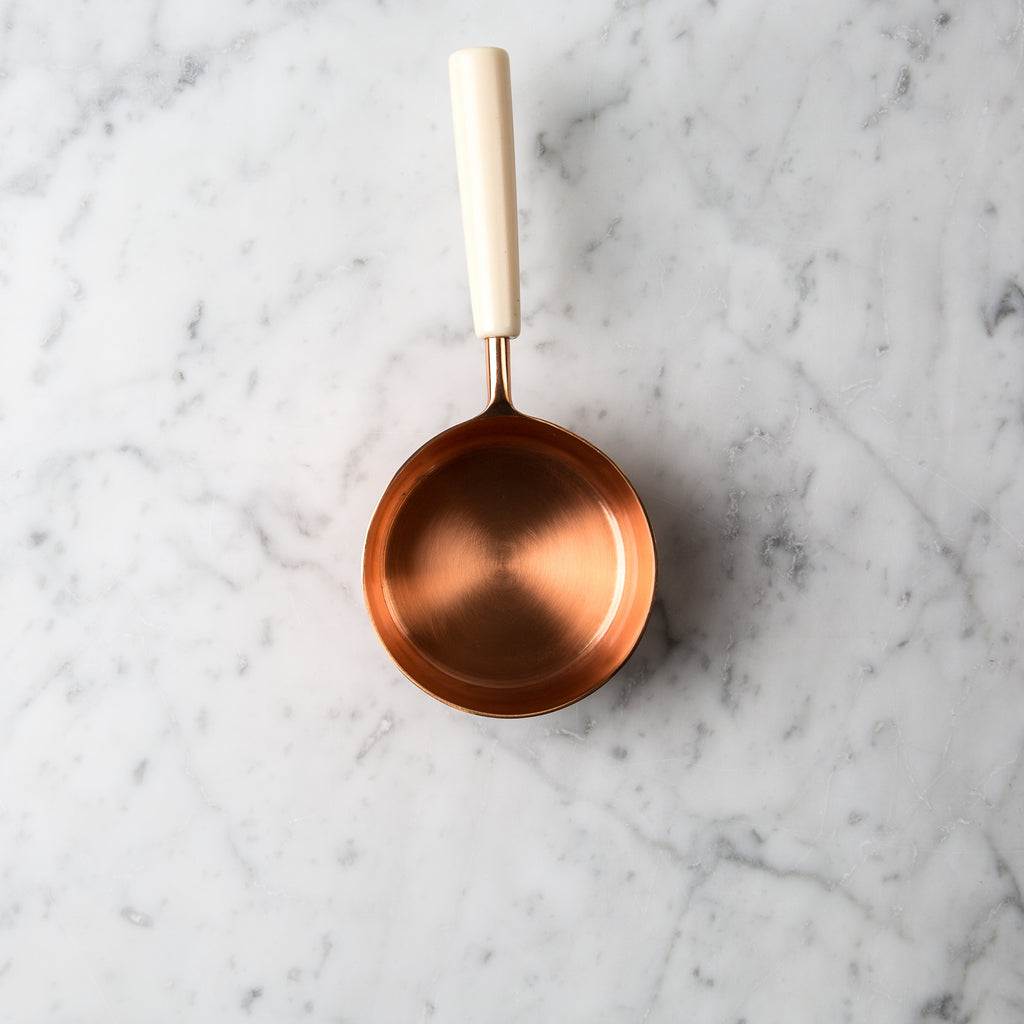 Copper and Ivory Measuring Cups