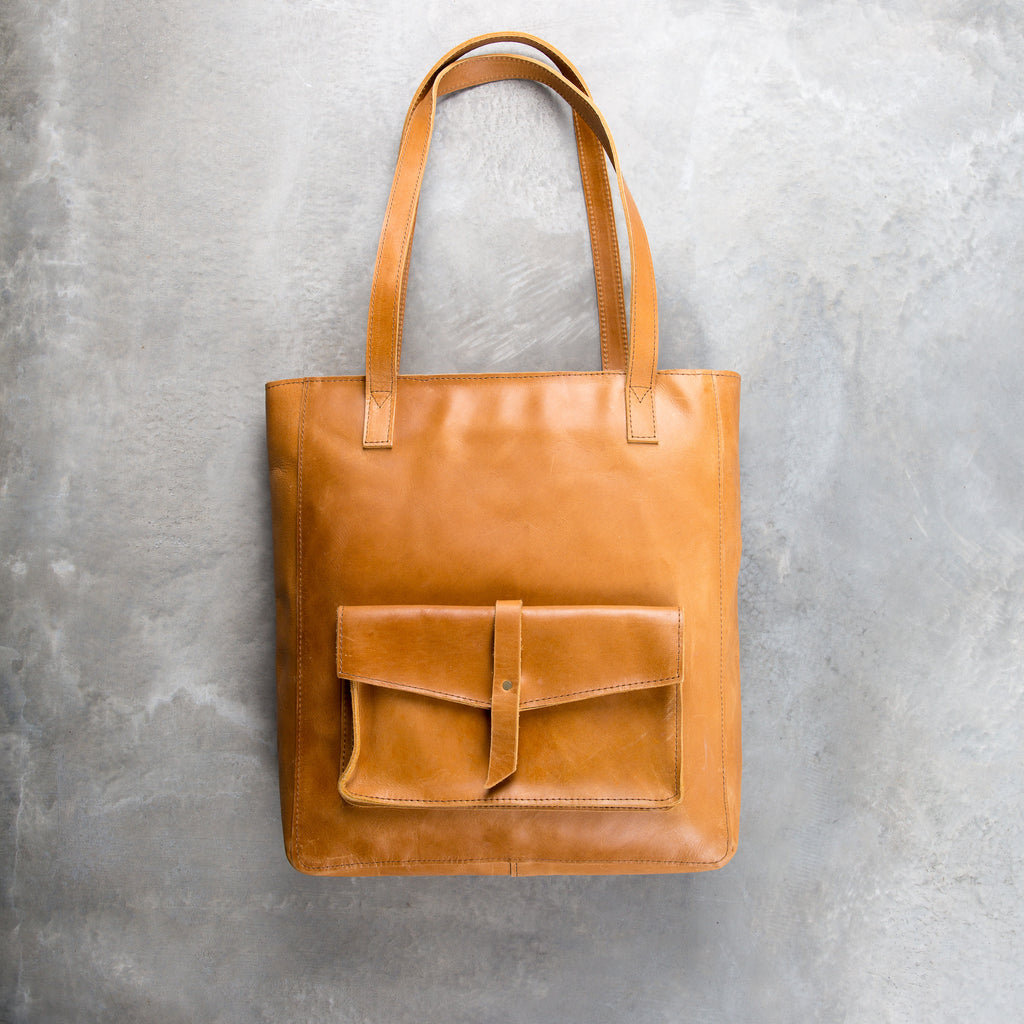 light brown leather tote with outside pocket
