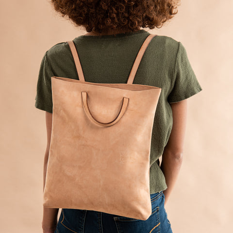 light brown leather convertible backpack and tote bag