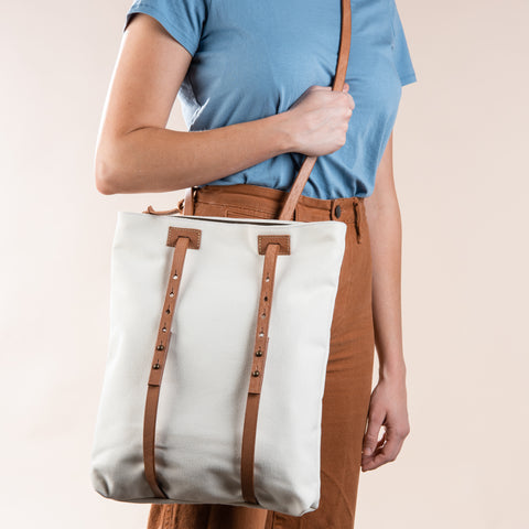 white cotton canvas convertible tote and backpack with leather straps
