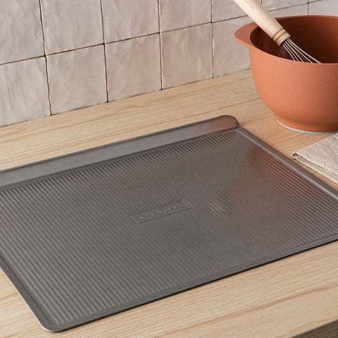 magnolia branded non-stick flat cookie sheet