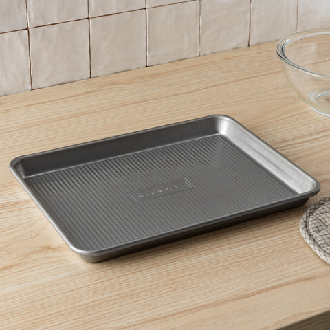 magnolia branded non-stick steel baking sheet