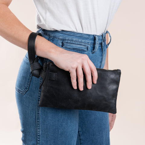 black leather wristlet with sipper closure