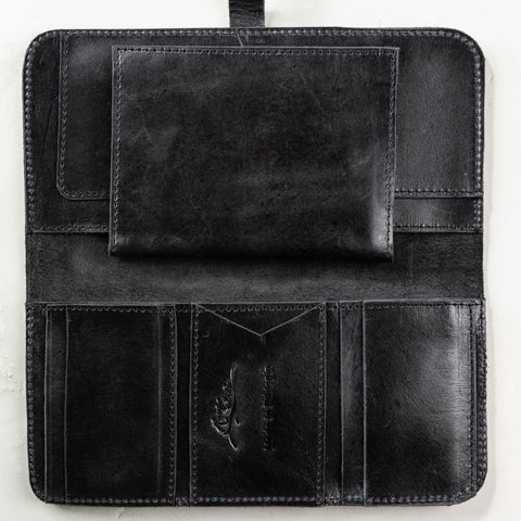 black leather wallet with passport holder included