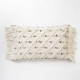 white textured lumbar pillow with diamond pattern and tassels