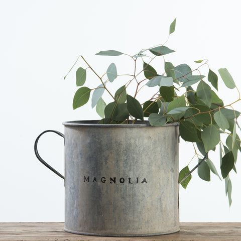 vintage metal bucket with handle and magnolia logo on side