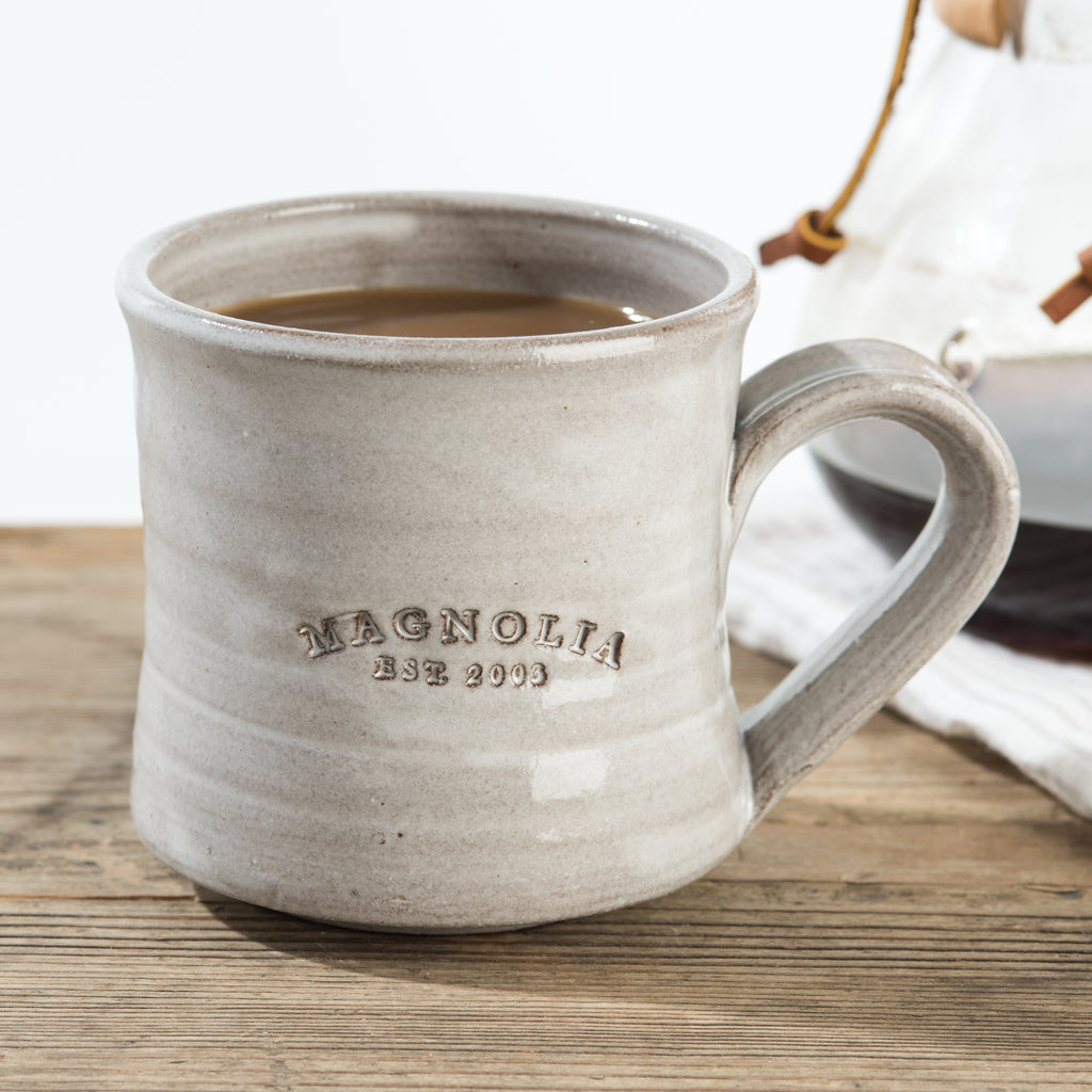 hand-thrown grey mug with magnolia established stamp