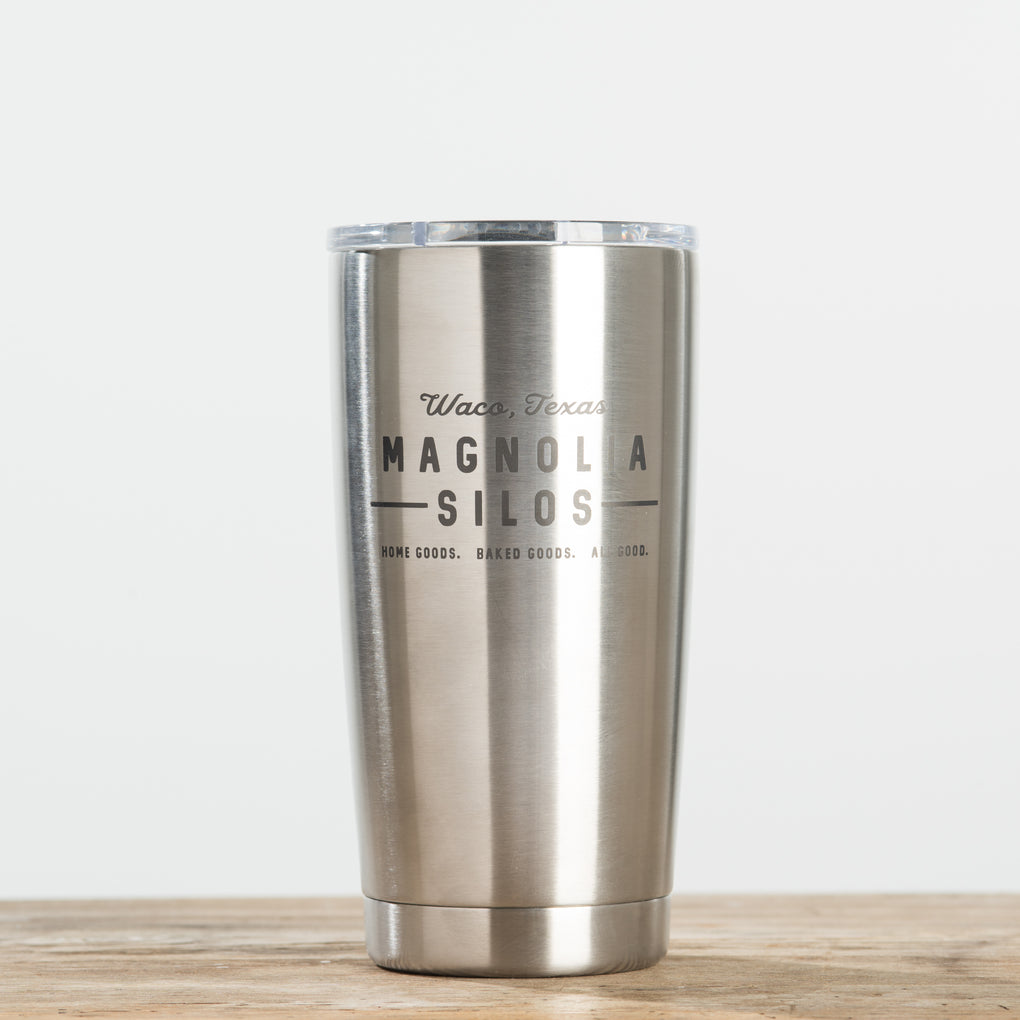 double-walled 20 ounce stainless steel tumbler with magnolia logo