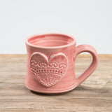 muted pink hand-thrown ceramic mug with heart detail