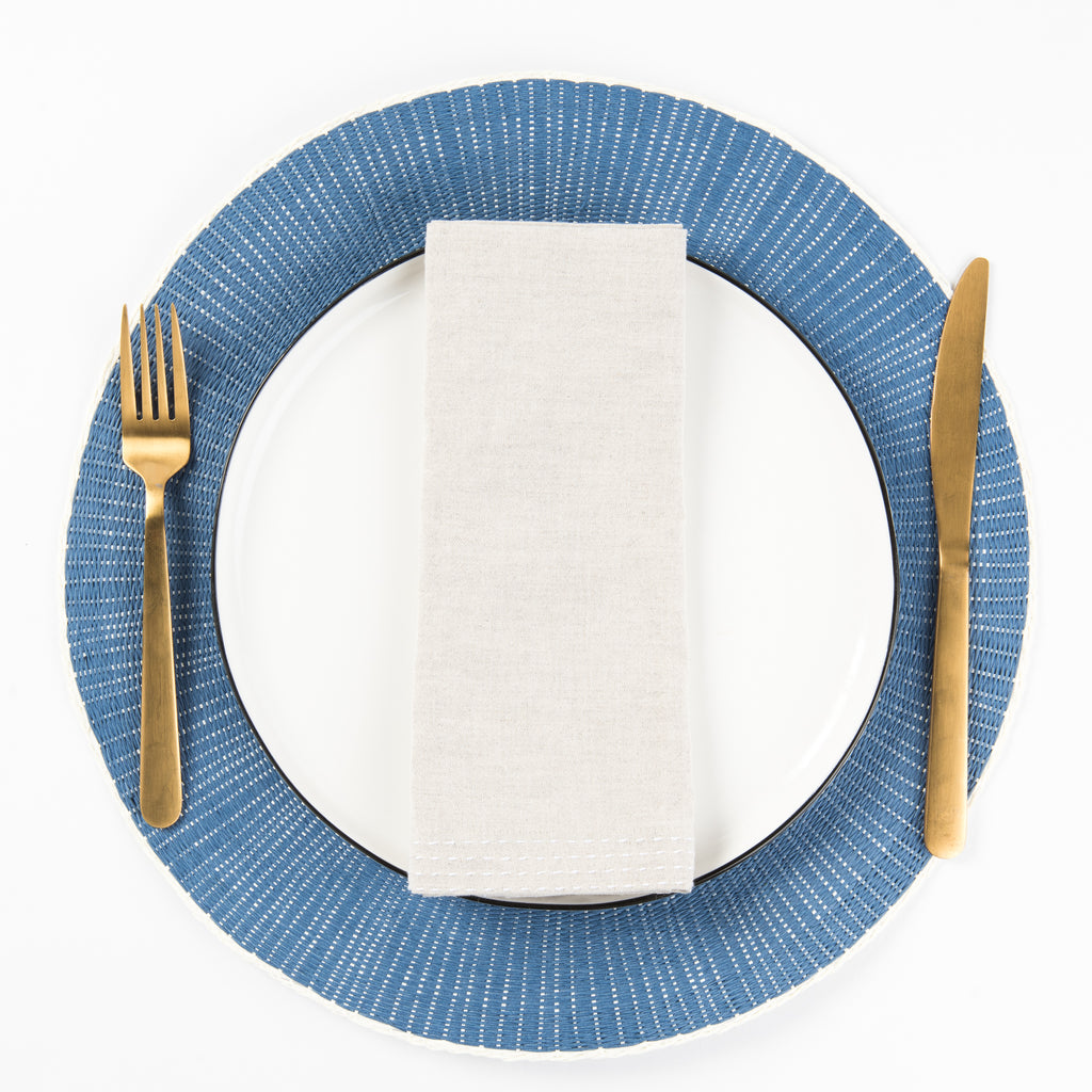 Round navy placemat with plate and silverware