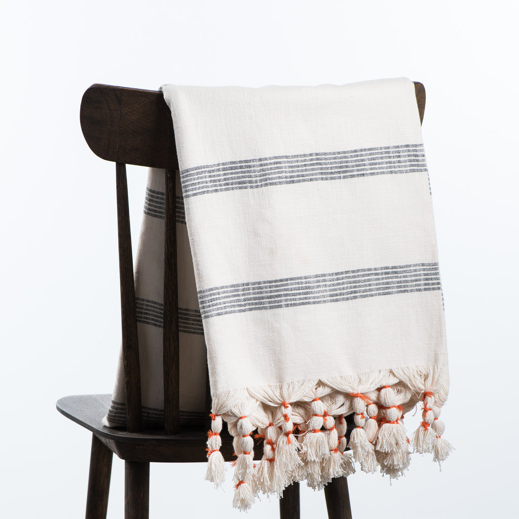 cream tasseled throw with black stripes
