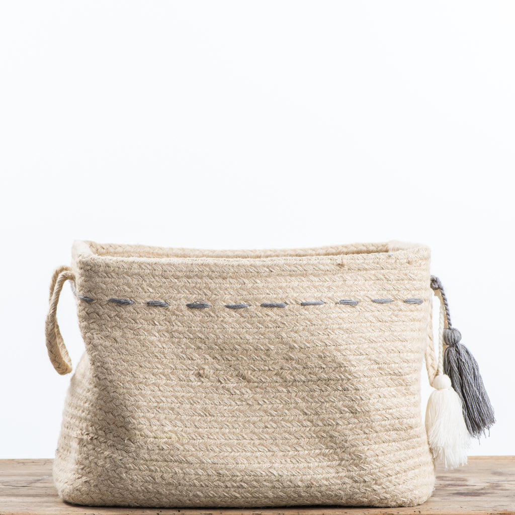 jute basket with handles and tassels