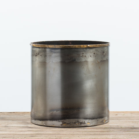 medium dark metal vessel with patina look