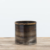 extra small dark metal vessel with patina look