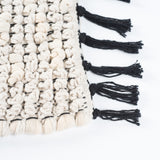 Black and white bath mat tassels