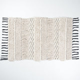 Black and ivory bath mat with fringe and tassels