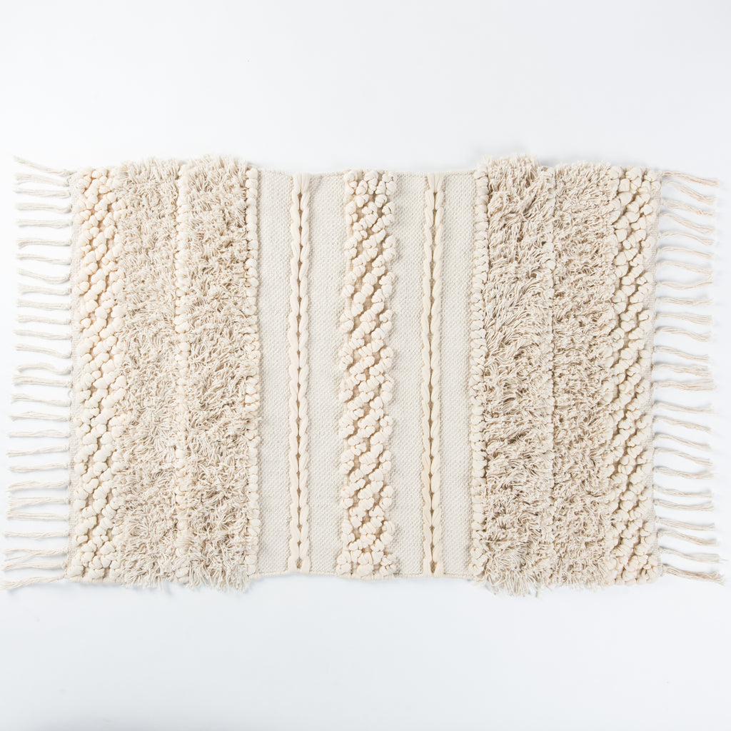 Ivory bath mat with fringe and tassels