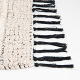 Black and ivory bath mat tassels