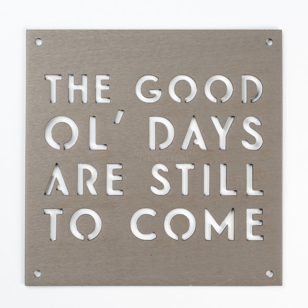 """the good ol days are still to come"" metal sign"