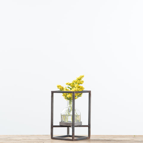 glass vase with metal frame stand