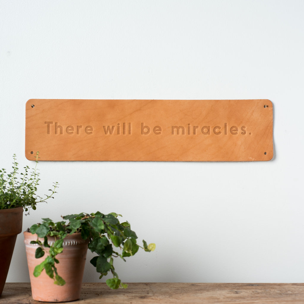 """Miracles"" Leather Sign"