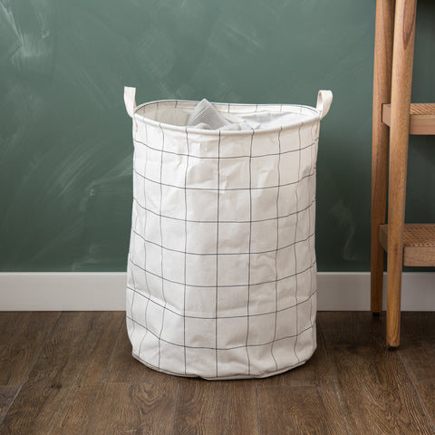 white cotton hamper with black grid pattern