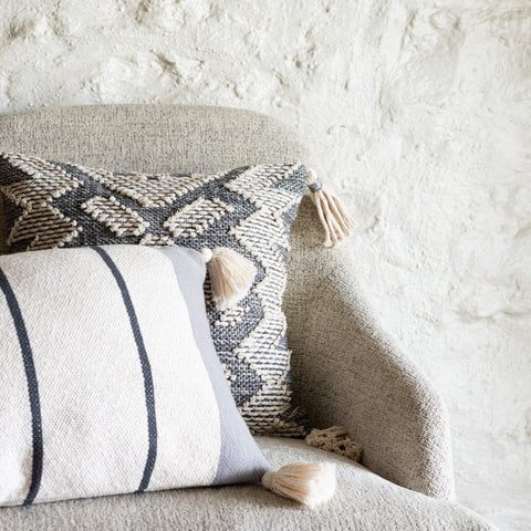 cream and charcoal striped pillow with corner tassels