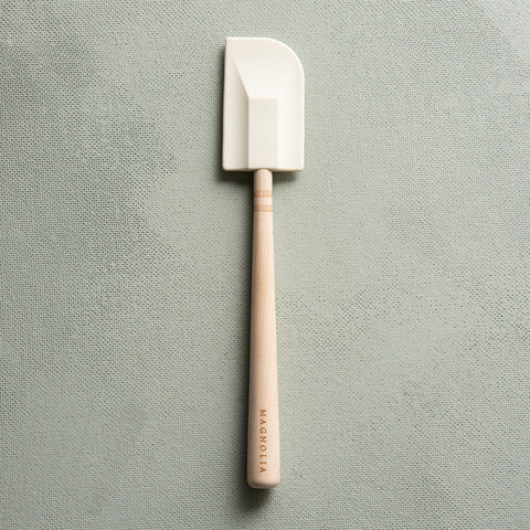 white silicone spatula with maple handle and magnolia logo