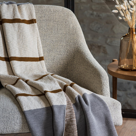 grey, bronze, and cream striped cotton throw blanket
