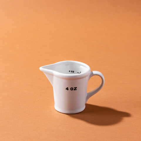 white ceramic measuring pitcher style cups