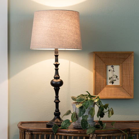black traditional table lamp with woven off-white shade